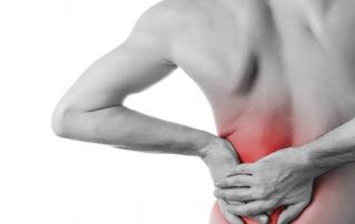 man suffering lower back pain
