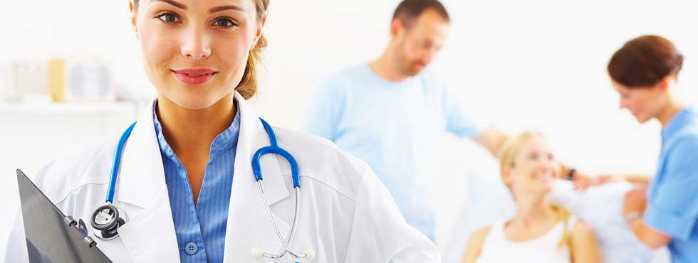 a pain management doctor is holding an application and two nurses are giving suggestions to the patient.