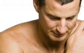 middle aged man with shoulder pain