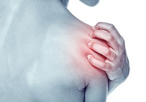 chronic shoulder pain on woman